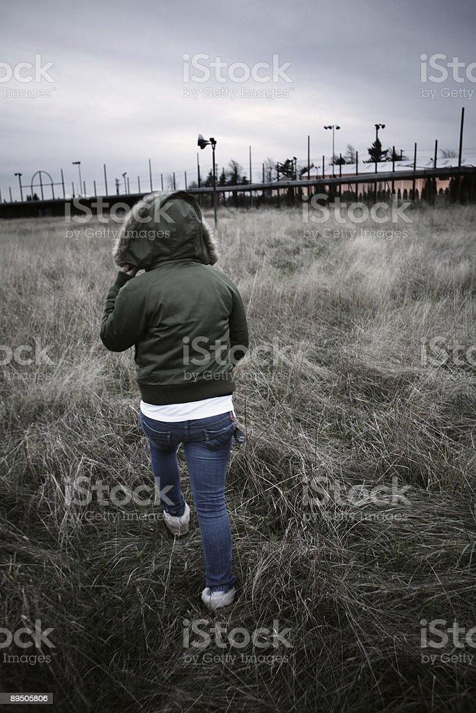 Person Walking Through Field royalty-free stock photo