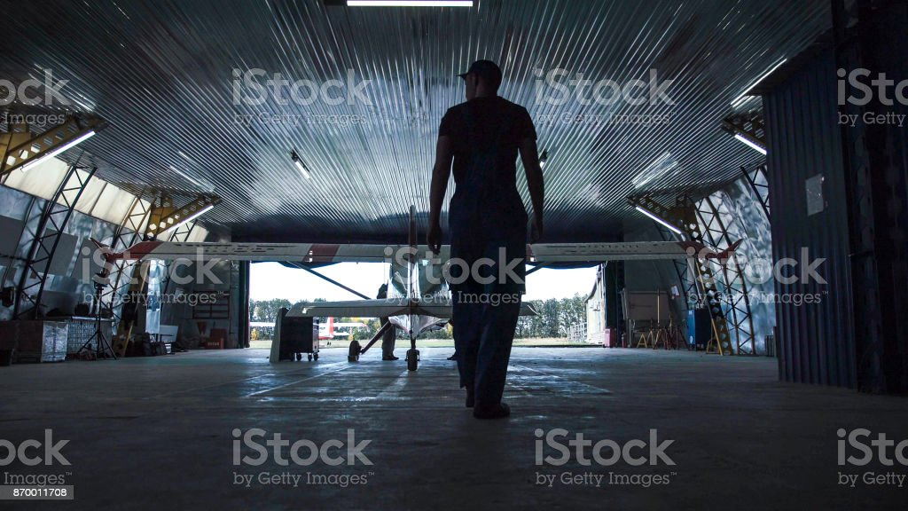 Person walking towards plane stock photo
