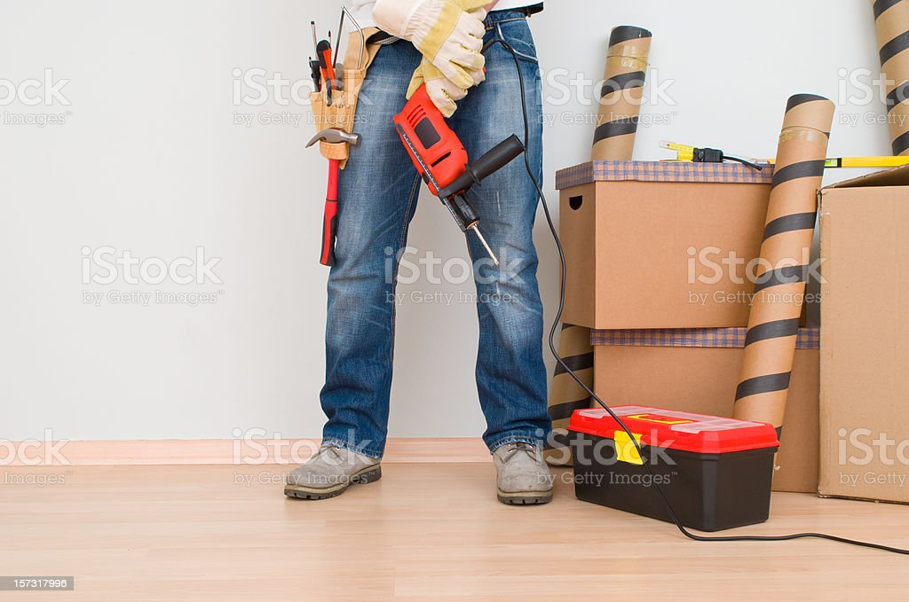 Person wearing a tool belt royalty-free stock photo