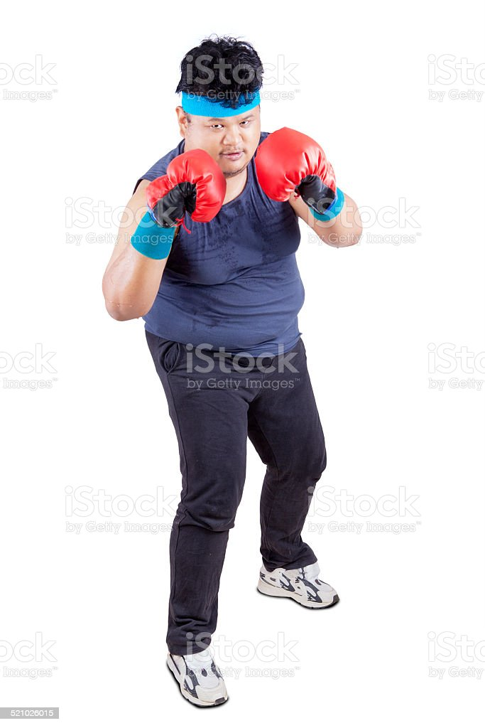 Person wearing boxing gloves stock photo