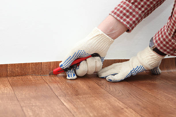 Person wearing gloves cutting linoleum with knife Construction worker cutting linoleum linoleum stock pictures, royalty-free photos & images