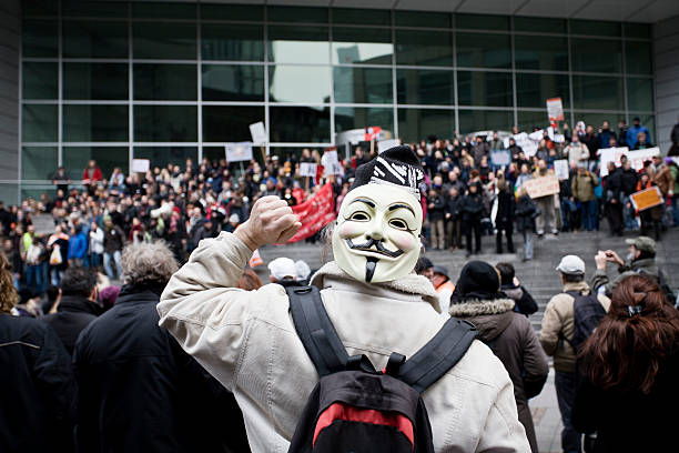 person wearing guy fawkes mask in his neck, occupy movement - guy fawkes mask stock photos and pictures
