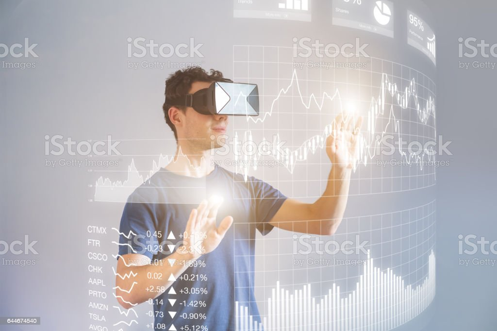 Person wearing VR headset for financial dashboard, key performance indicators stock photo