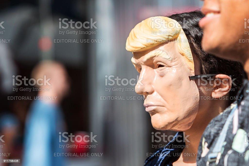 Person Wears Donald Trump Mask At Atlanta Halloween Parade stock photo