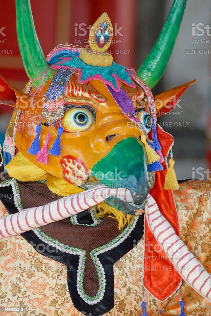 Person wears traditional shaman's mask and costume in Ulaanbaatar, Mongolia. stock photo