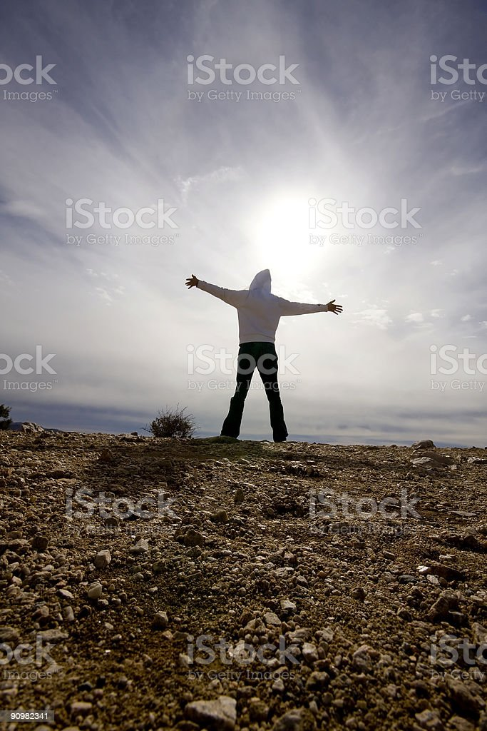 Person with Arms Outstretched stock photo