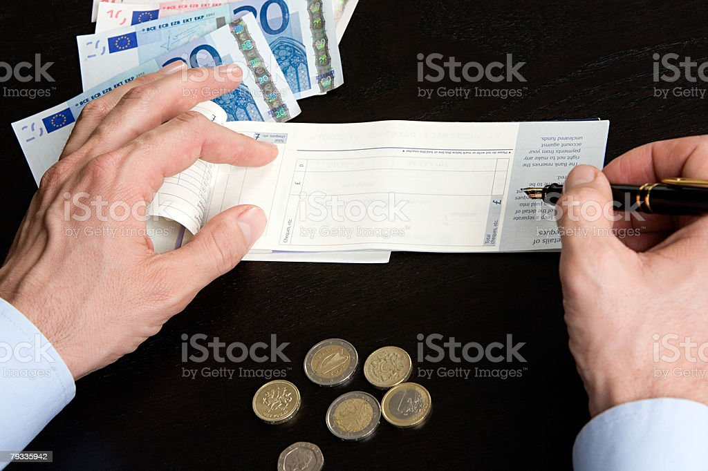 Person with cheque book 免版稅 stock photo