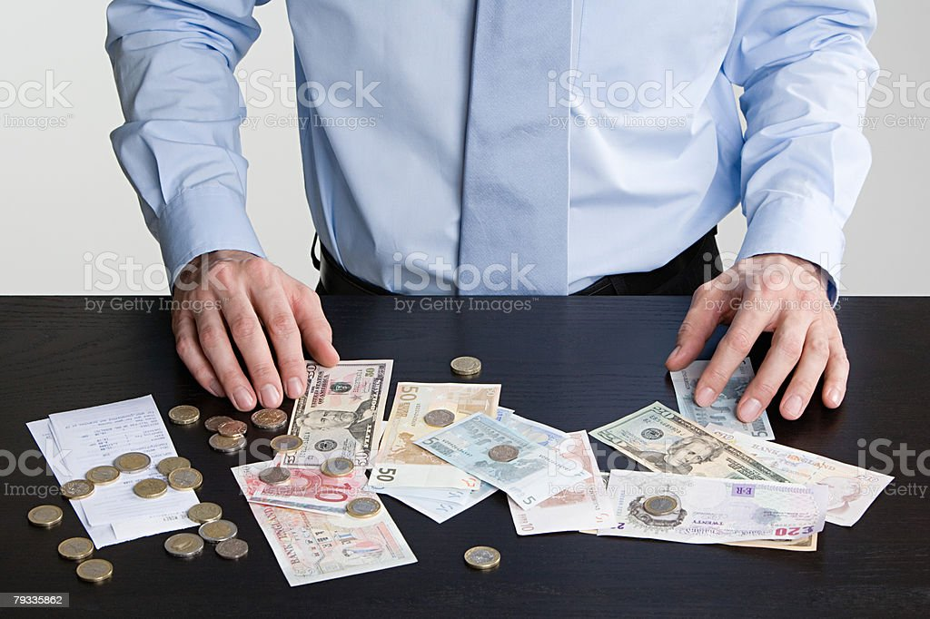 Person with currency 免版稅 stock photo