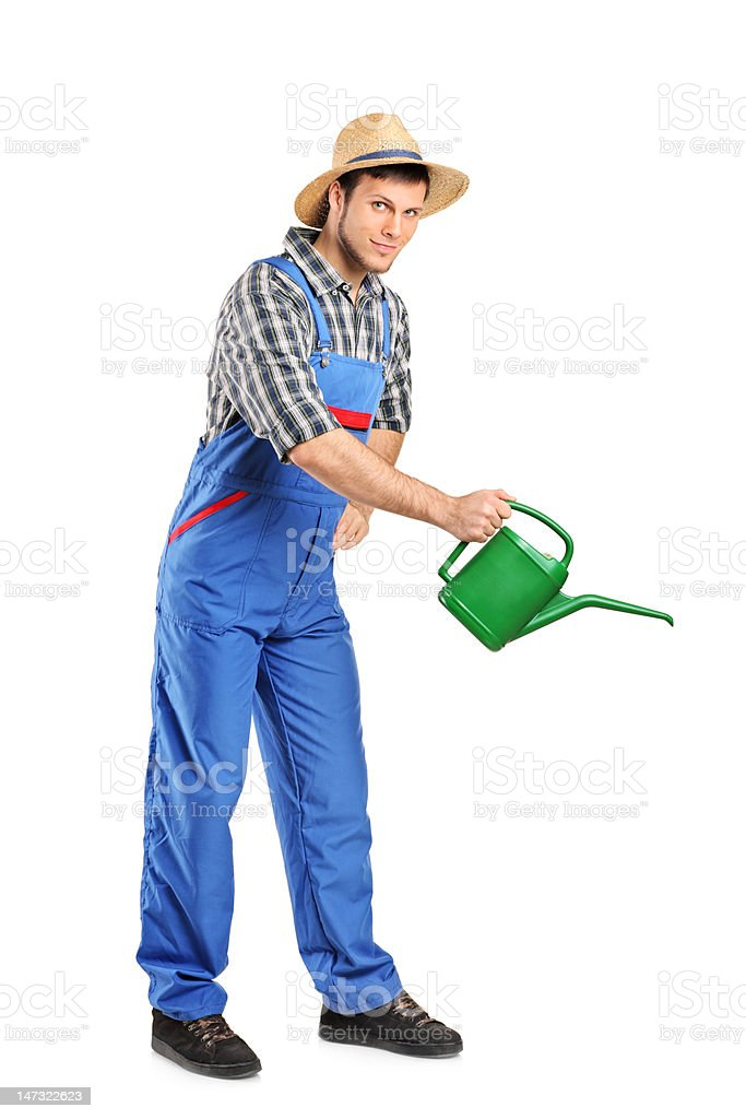 Person with holding a watering can stock photo