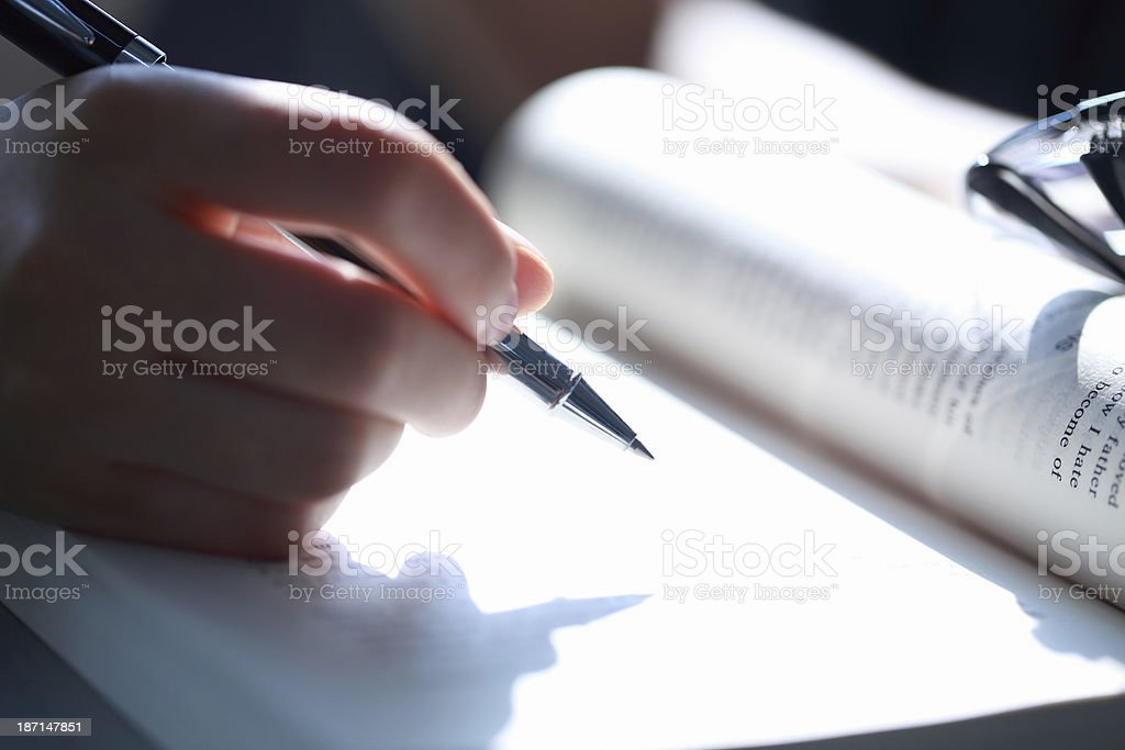 Person with Pen and Book stock photo