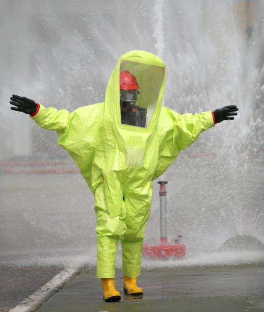 Person with protective suit against chemical and bacteriological stock photo