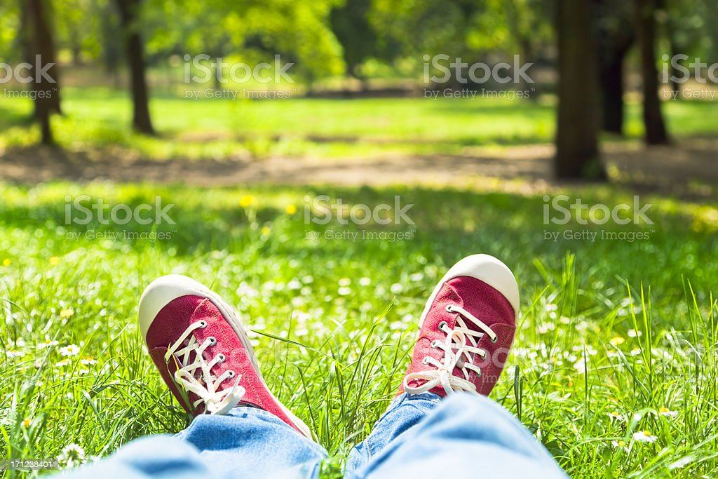 Person with red shoes in park in Rome royalty-free stock photo