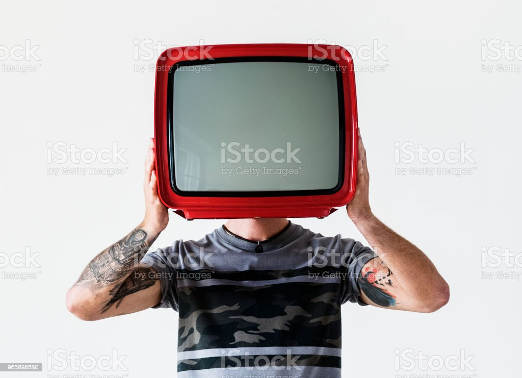 Person with tattoo holding television - Royalty-free Addict Stock Photo