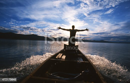 istock A person with their hands spread on the edge of a boat 472175645