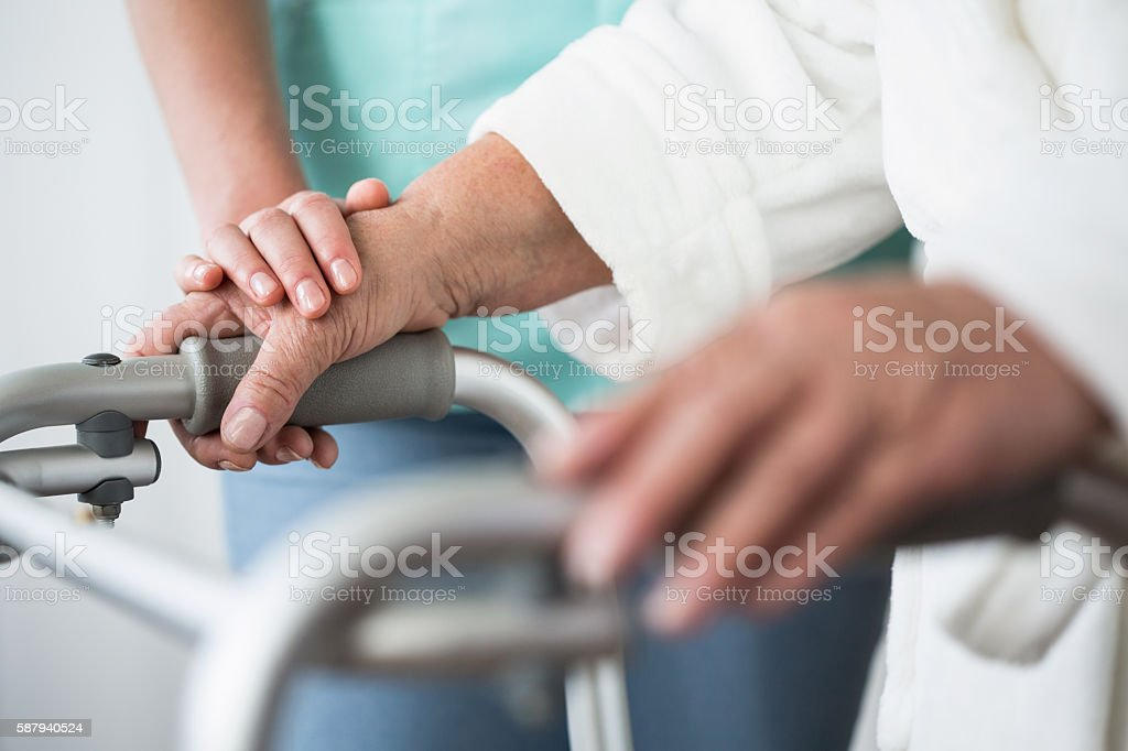 Person with walking zimmer stock photo