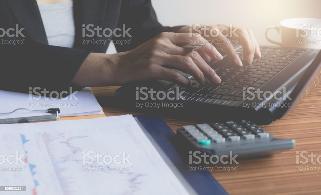 Person working and using a laptop for business and accounting concept. stock photo