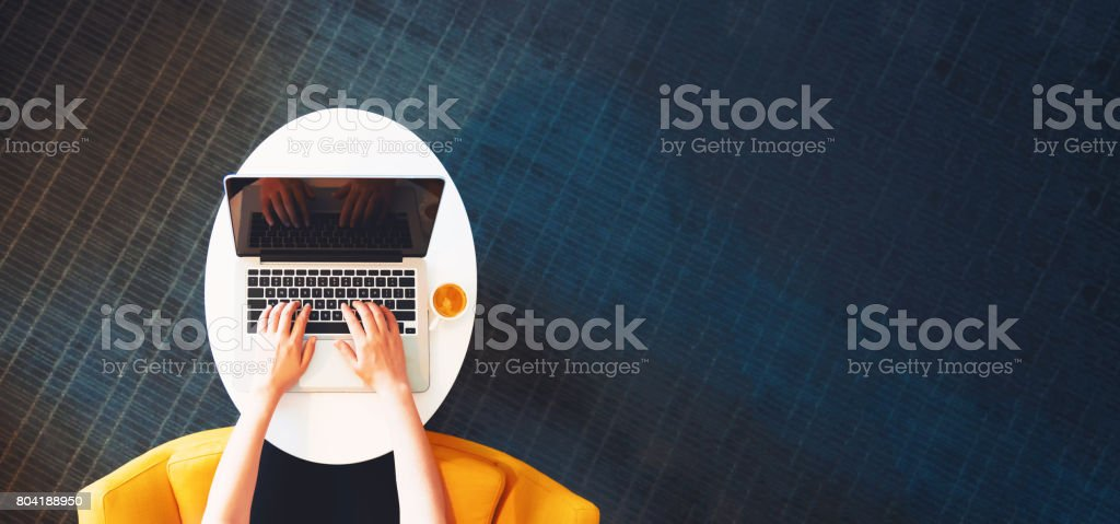Person working on a laptop computer from overhead royalty-free stock photo