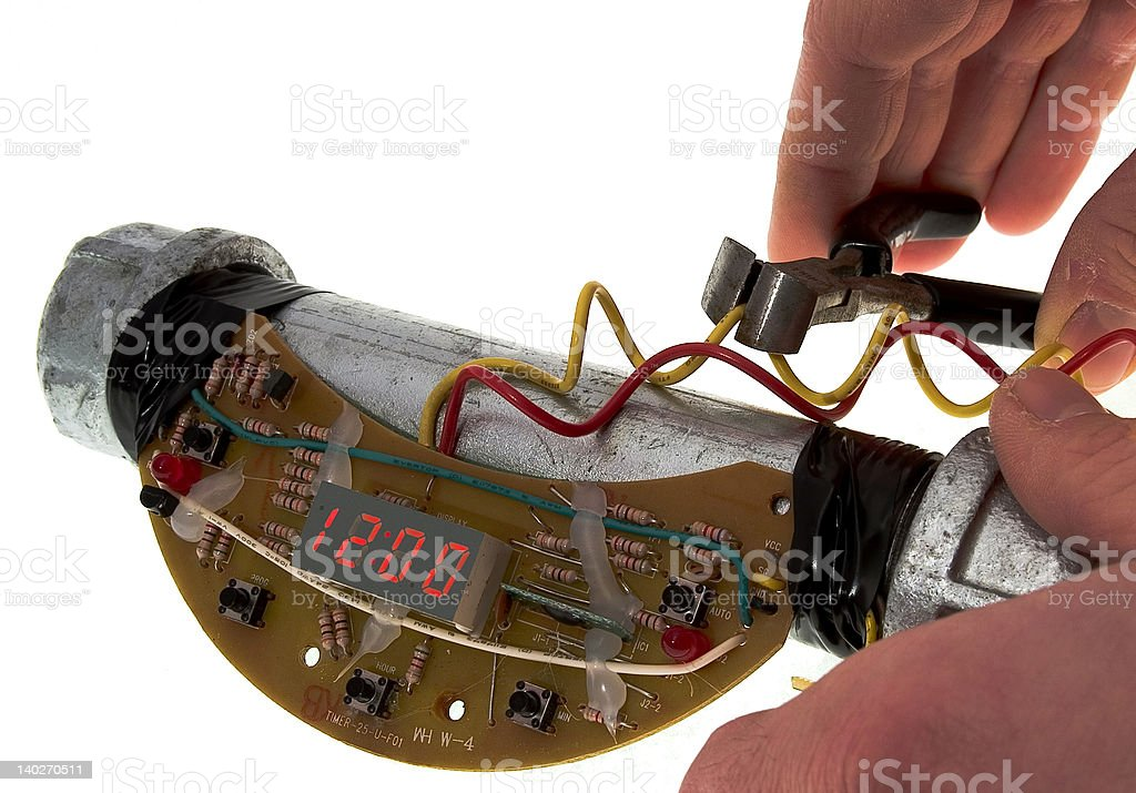 A person working on a time bomb royalty-free stock photo