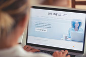 Person working on an online study website. The website has an image of a woman and links to different e-learning education facilities for home schooling