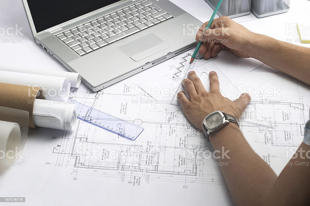 Person working on measurements for a drawing of a building royalty-free stock photo