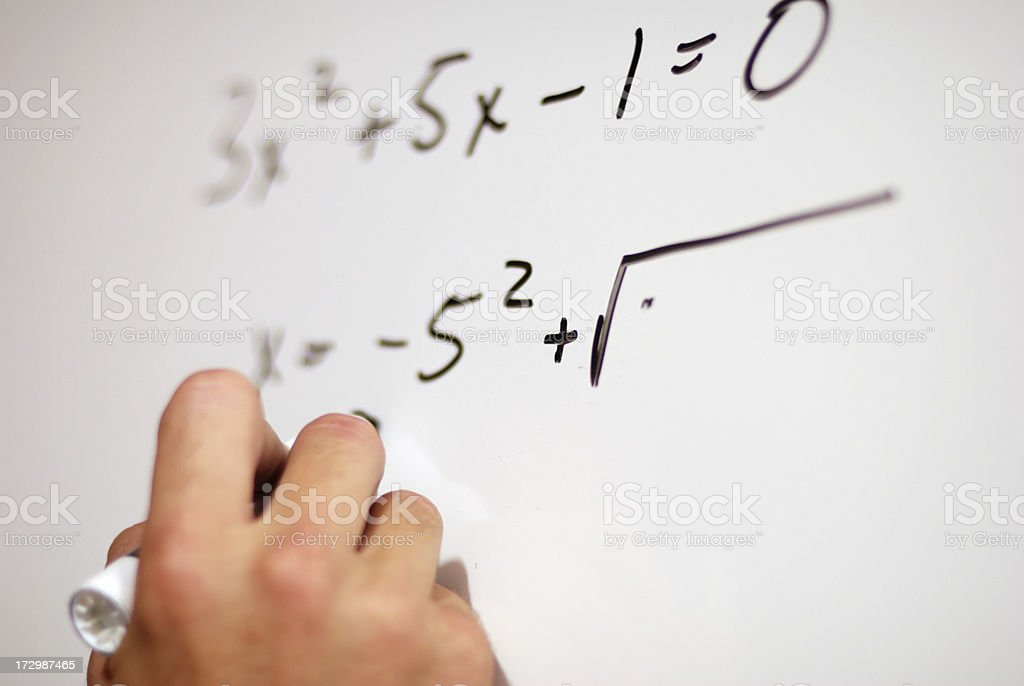 A person writing math equations on a whiteboard royalty-free stock photo