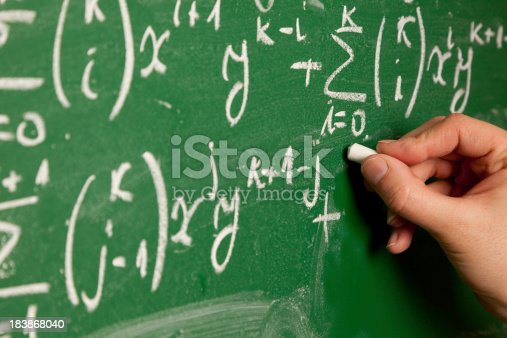 istock Person writing mathematical equation on chalkboard 183868040