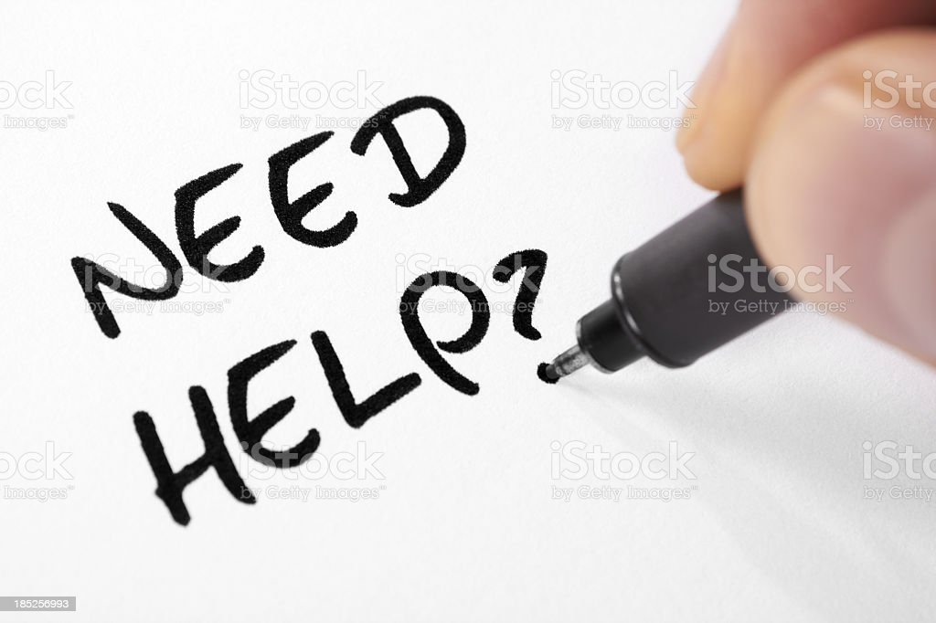 Person writing need help with a question mark in marker  stock photo