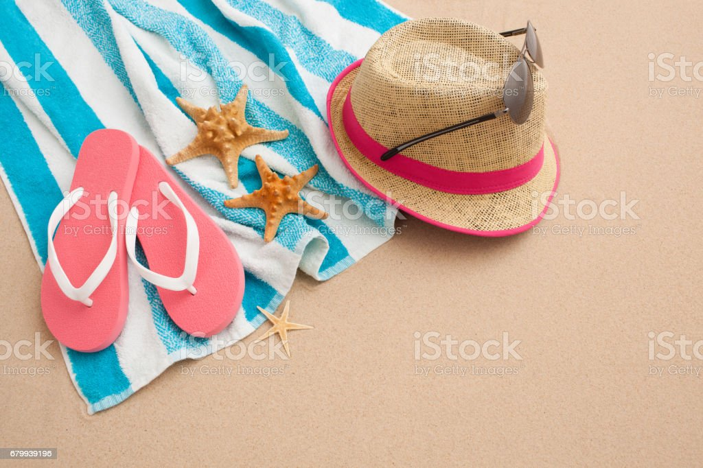 Personal beach accessories on beach sand. Beach holiday vacation...