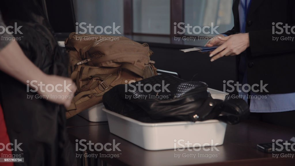 Personal belongings in a tray at the x-ray scanner stock photo