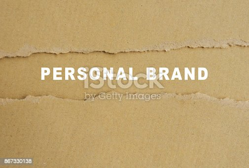 874270826istockphoto Personal brand words on torn brown paper 867330138