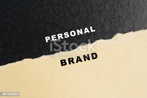 874270826istockphoto Personal brand words on torn brown paper 867333952
