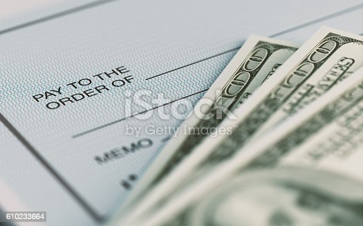 istock Personal Check and American Dollars With Selective Focus 610233664