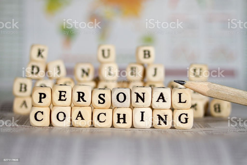 personal coaching word on newspaper background stock photo