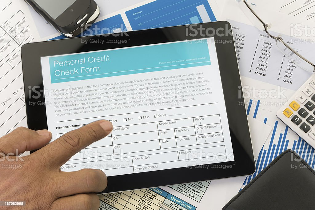 Personal credit check form on a digital tablet stock photo