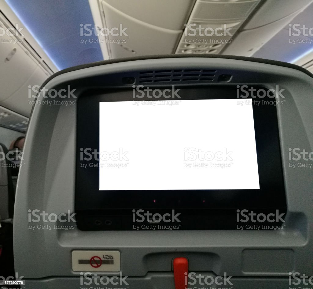 Personal entertainment screen of seat in airplane stock photo