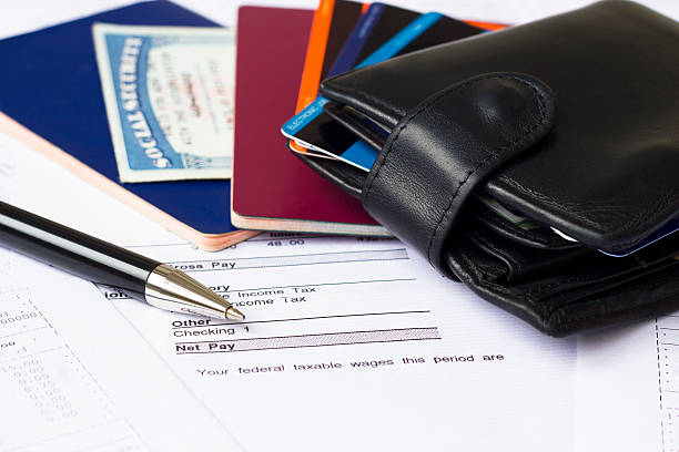 personal finances - social security check stock photos and pictures