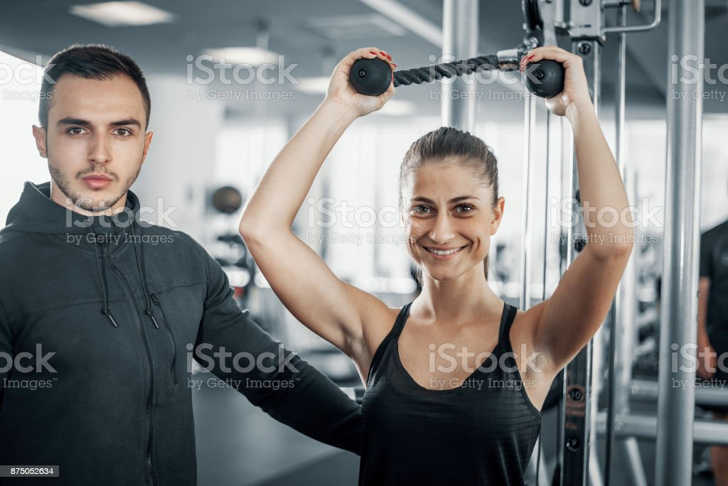 300331eacbc Personal Fitness Trainer With His Client In Gym Stock Photo   More ...