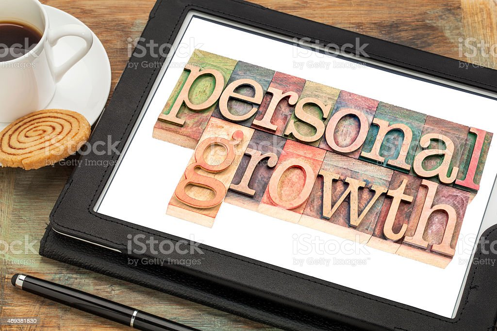 personal growth typography on tablet stock photo