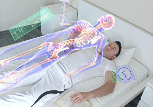 A man lying down doing personal health screening.