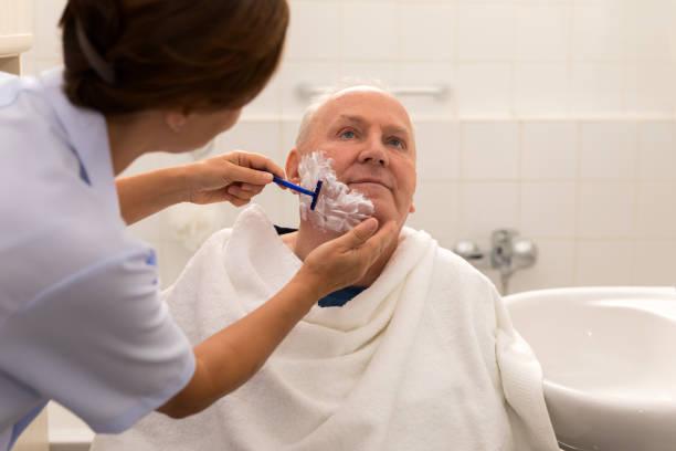 Personal hygiene home caregiver with senior man in bathroom picture id995306360?b=1&k=6&m=995306360&s=612x612&w=0&h=yifs blp8zonng0tdjnx3gyvdv16cadciyugxqvv97e=