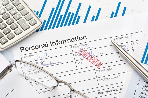 Personal information form with confidential stamp Close up of personal information form with confidential stamp privacy stock pictures, royalty-free photos & images