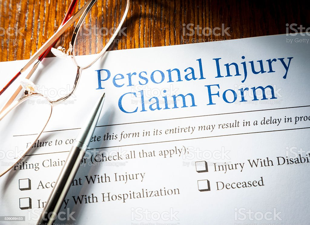 Personal Injury Claim form Personal Injury Claim form with pen and glasses 2015 Stock Photo