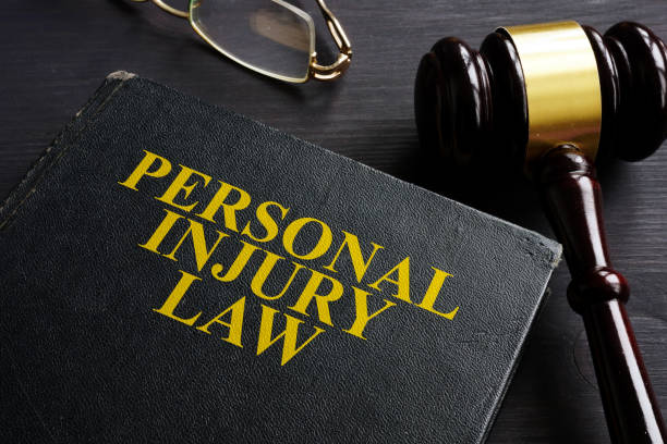 Personal Injury Law book and a black desk. stock photo