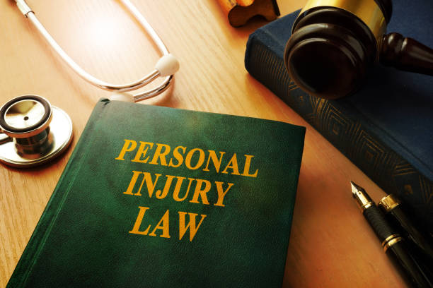 Personal injury law book on a table. stock photo