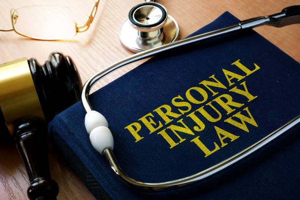 Personal Injury Law concept. Book and stethoscope. stock photo