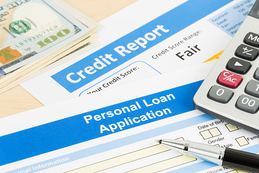 512011833 istock photo Personal loan application form fair credit score with calculator, dollar money, and pen 1083337116