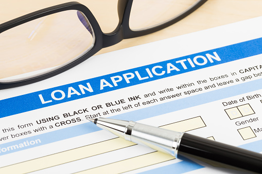 512011833 istock photo Personal loan application form with glasses, and pen 1083337038