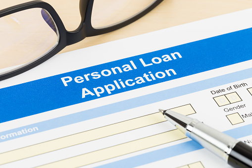 512011833 istock photo Personal loan application form with glasses, and pen 1083337072