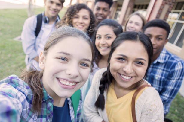 Personal perspective of teenagers taking a selfie stock photo