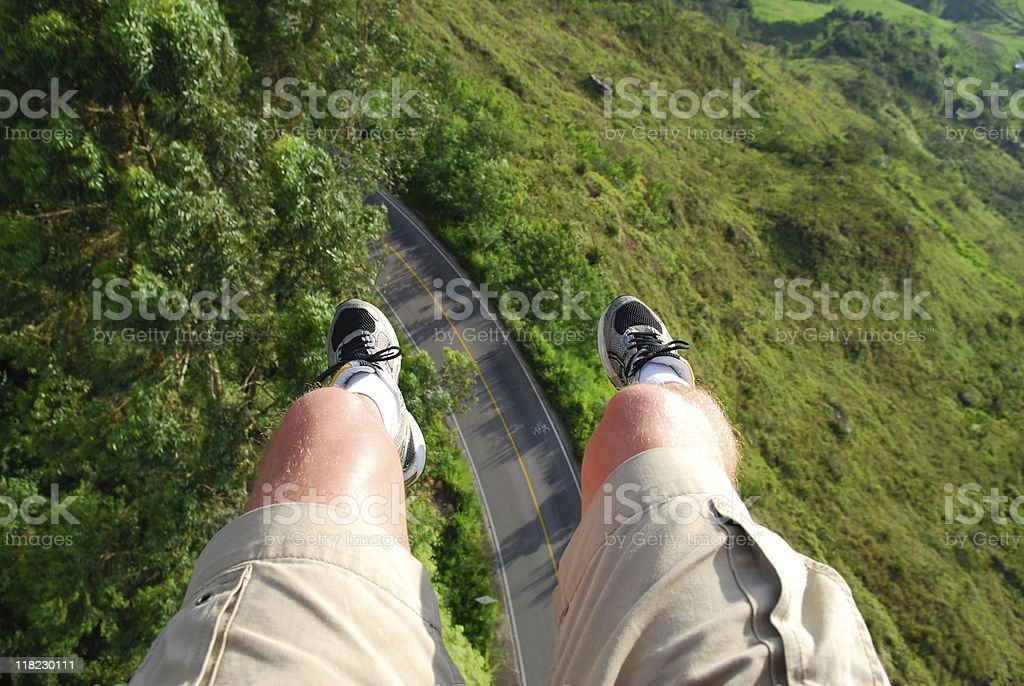 Dangling legs of a paraglider in Bucaramanga, Colombia stock photo